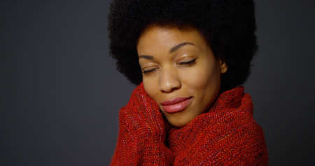 american content: Black woman with afro wearing red shawl