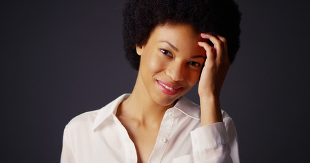 Attractive young black woman with afro looking at camera photo