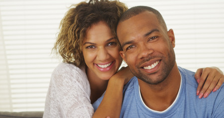young man smiling: Happy Black couple smiling Stock Photo