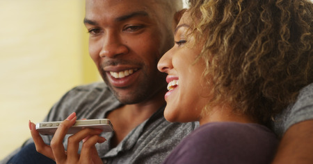 Black couple talking on smartphone