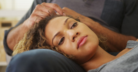 Closeup of girlfriend lying on boyfriends lap Stock Photo