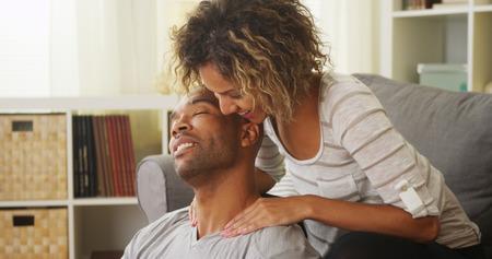 therapeutic: Black girlfriend giving boyfriend massage Stock Photo