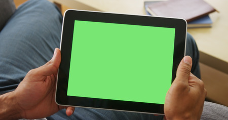 screen: Closeup of tablet with greenscreen Stock Photo