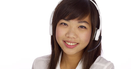 telemarketer: Chinese telemarketer looking at camera
