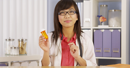 Asian doctor explaining prescription Stock Photo
