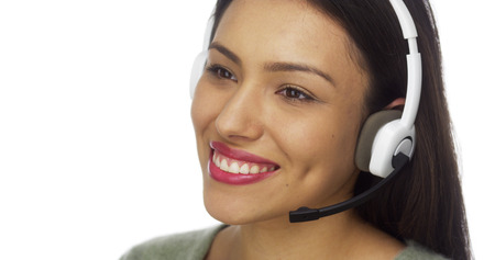 telemarketer: Mexican woman telemarketer talking and smiling
