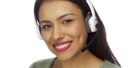 telemarketer: Mexican woman telemarketer smiling