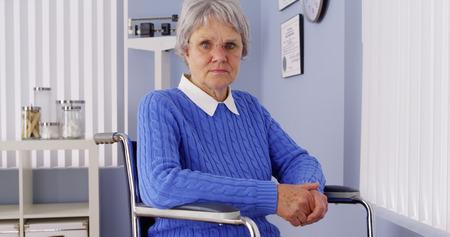Senior woman looking at camera in wheelchair photo