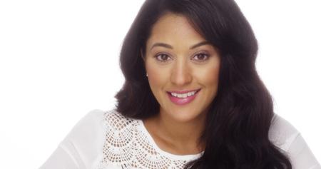 Hispanic woman smiling at camera