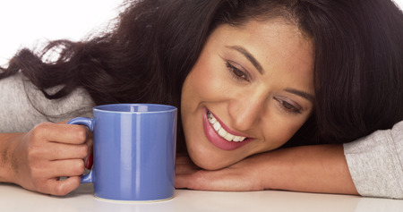 Mexican woman smiling with coffee photo