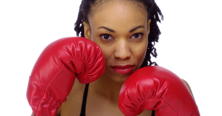 Black woman wearing boxing gloves