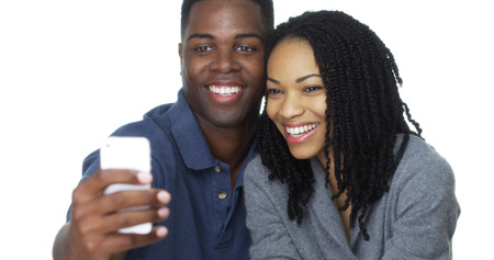 african american male: Happy young Black couple taking selfie together and laughing