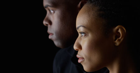 Dramatic profile rack focus of two young black people photo