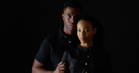 woman serious: Dramatic portrait of strong young black couple