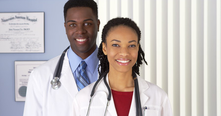 Close up of of smiling African American doctors in photo