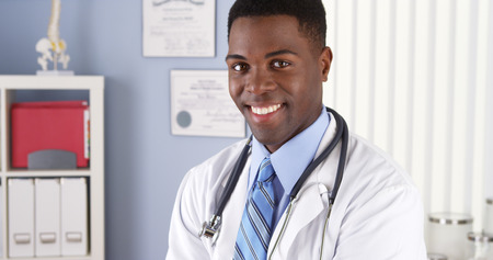 Smiling African American doctor in medical office photo