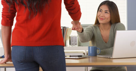 assigning: Asian manager assigning task to employee