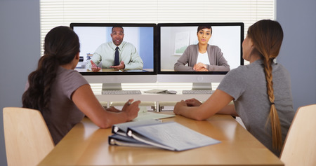 web conference: Professional team of multi-ethnic business colleagues having a video conference Stock Photo