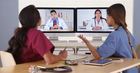 Group of diverse medical doctors video conferencing Foto de archivo