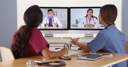 mature mexican: Mixed race team of medical doctors talking over the internet