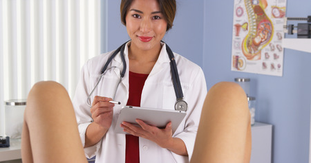 Japanese gynecologist examine patient in hospital exam room Stock Photo