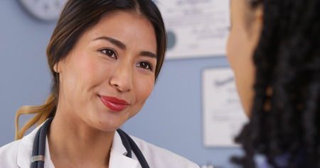 Close up of Japanese physician looking at patient