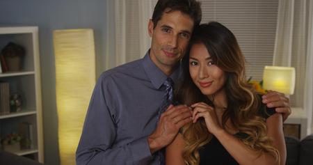 Interracial couple smiling at camera photo