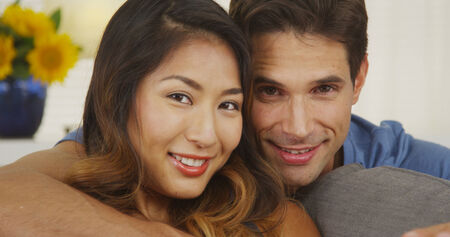 young couple smiling: Portrait of a happy mixed race couple Stock Photo