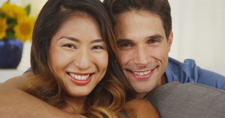 Happy mixed race couple smiling