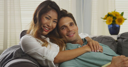 Attractive mixed race couple smiling at camera