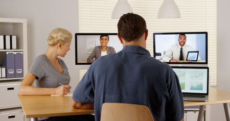 skype: Happy multi-ethnic businessteam working together