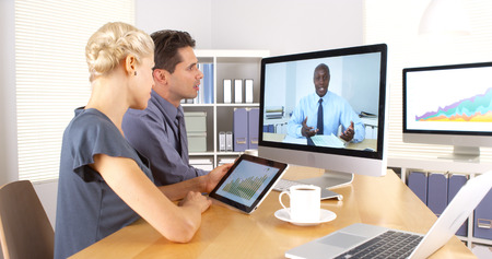 skype: African businessman congratulating employees for their hardwork
