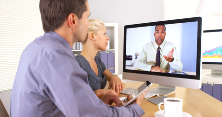 skype: Businessteam consulting supervisor about project Stock Photo