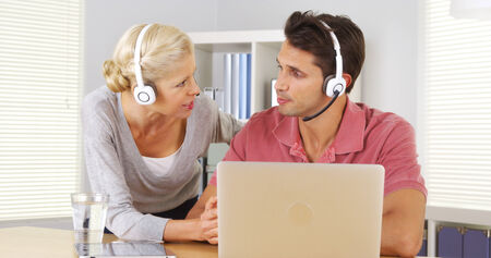 teleconference: Two business colleagues having a video conference on laptop Stock Photo