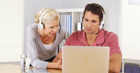 skype: Two business colleagues having a video conference on laptop Stock Photo