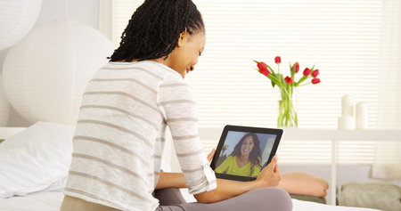 skype: Multi-ethnic friends talking online with tablet