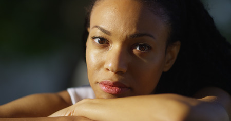 depressed woman: African woman crying outdoors