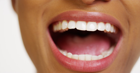 mouth close up: Close up of African woman with white teeth smiling