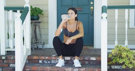 Mixed race woman jogging photo