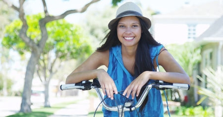 Young woman smiling on bike photo