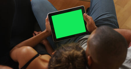 blank tablet: African couple holding tablet with greenscreen Stock Photo