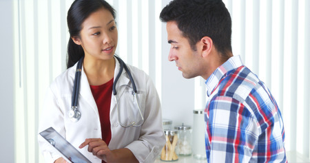 Chinese doctor explaining neck xray to patient