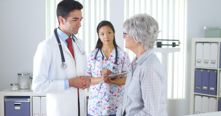 mature mexican: Hispanic doctor talking with elderly patient Stock Photo