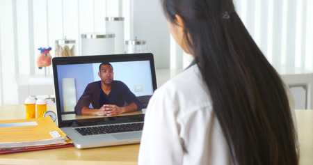Chinese doctor video chatting with African patient