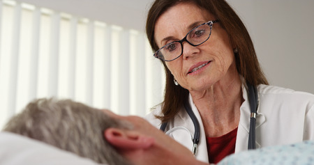 Doctor talking to elderly patient photo