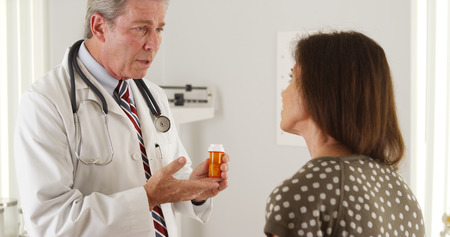 Doctor explaining prescription to elderly woman patient Standard-Bild