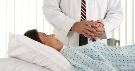 Doctor holding patients hand photo