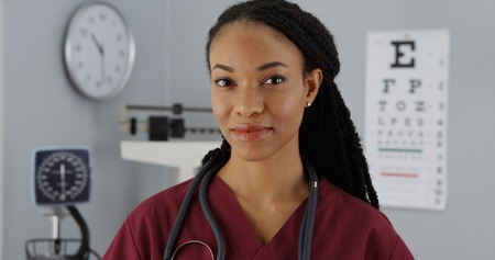 general knowledge: Successful Black woman doctor smiling at camera