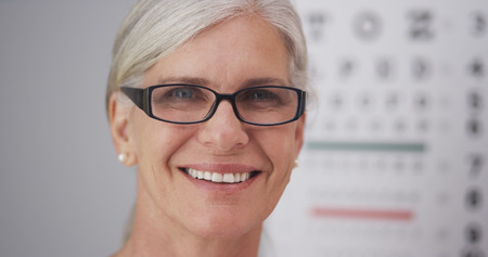 Beautiful mature woman wearing prescription eyeglasses.