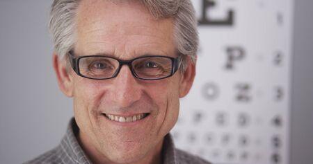 care providers: Elderly male wearing prescription glasses.